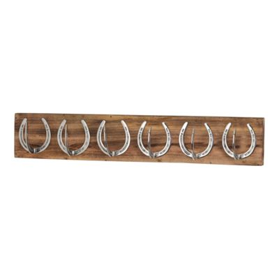 Six Nickel Horse Shoe Hooks On Wooden Board