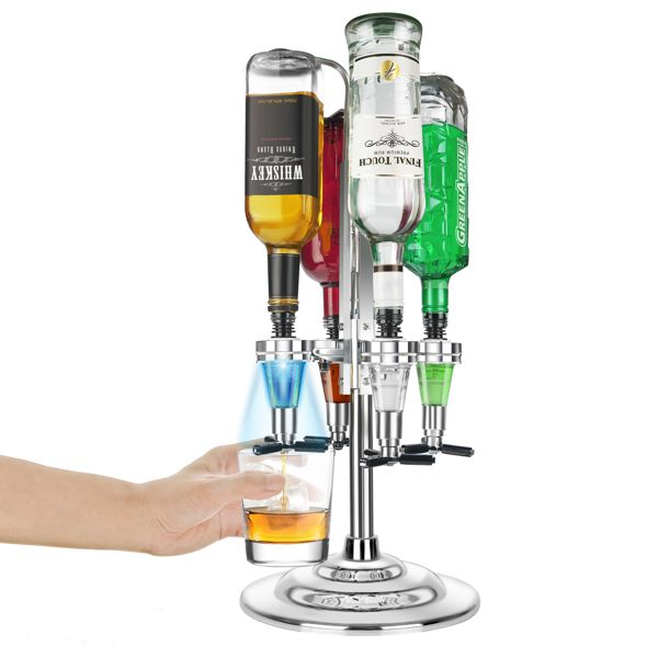a hand holding a glass filling it with alcohol from a bottle on a spirit dispenser stand