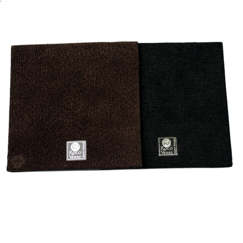 reverse of a black and brown square placemat on a white table
