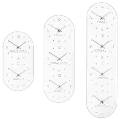 close up of 3 white vertical timezone wall clocks