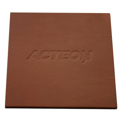 brown square leather coaster with embossed company name