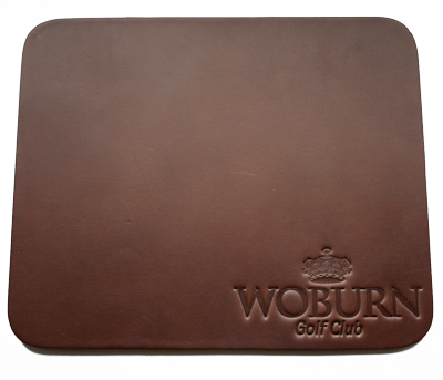 brown leather mouse mat with embossed logo in bottom right hand corner