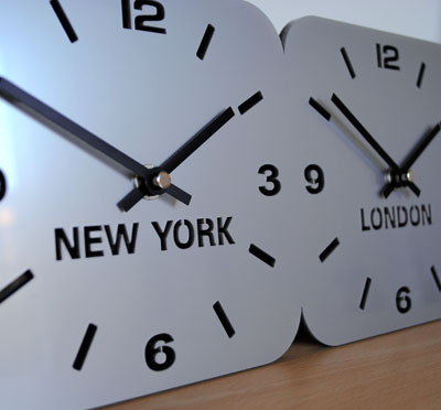 close up of dial on silver acrylic timezone wall clock