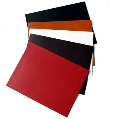 row of rectangle leather place-mats in red, brown, white, tan and black