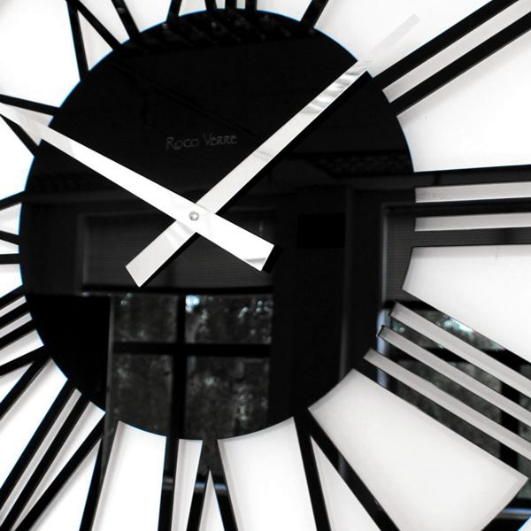 side view of a black acrylic round skeleton wall clock