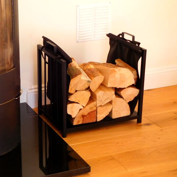 close up Vail Fireplace Log Holder and Log Carrier full of logs next to log burner