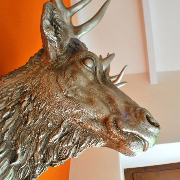 side view of large silver resin trophy wall stag head