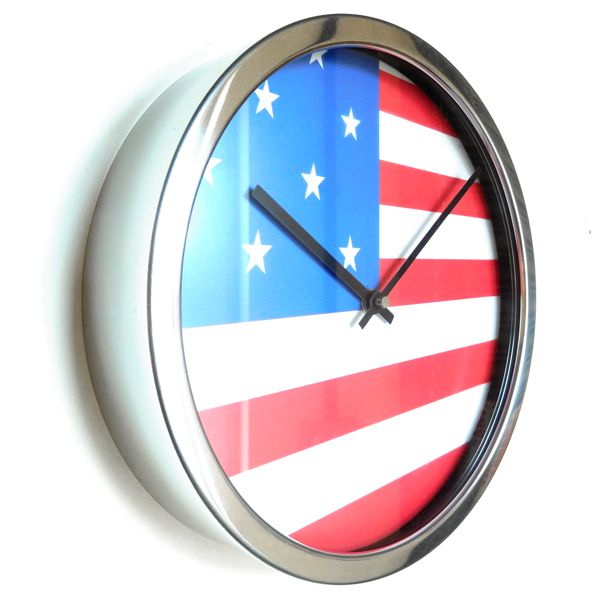 side view of a round wall clock with american national flag and silver surround