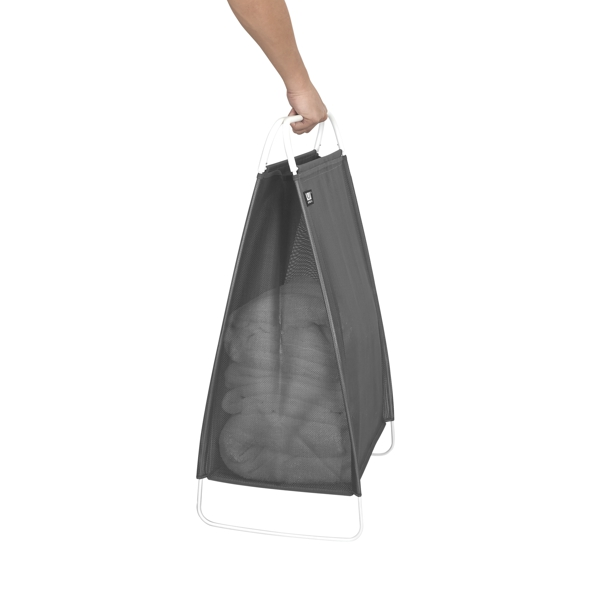 hand carrying grey fabric and metal frame laundry hamper