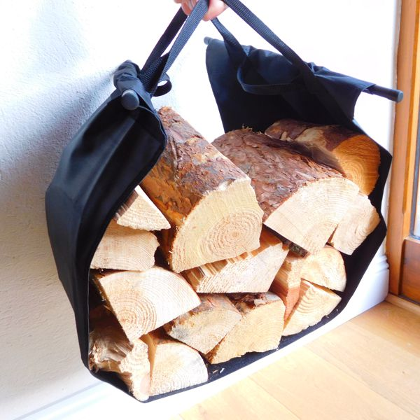 close up of black log carrier full of logs