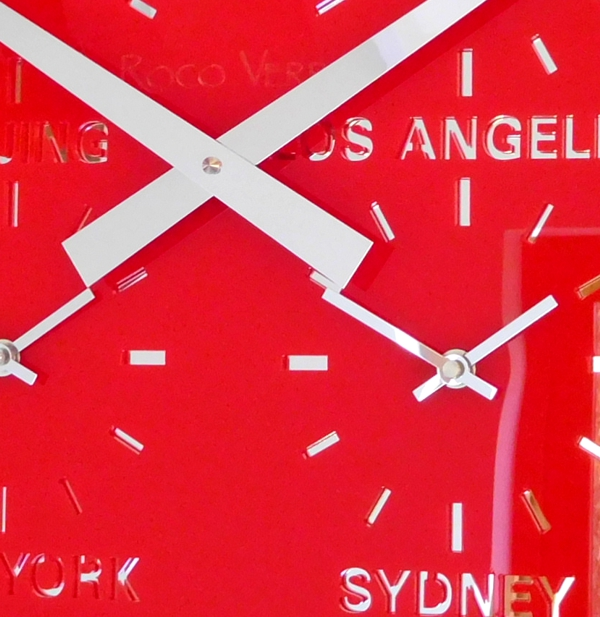 close up red four dial timezone clock