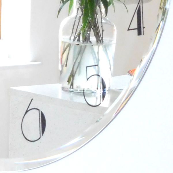 another view of the round mirror wall clock with black deco style numbers