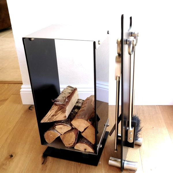black glass and brushed steel contemporary log holder and fireside companion set on wooden floor next to windo