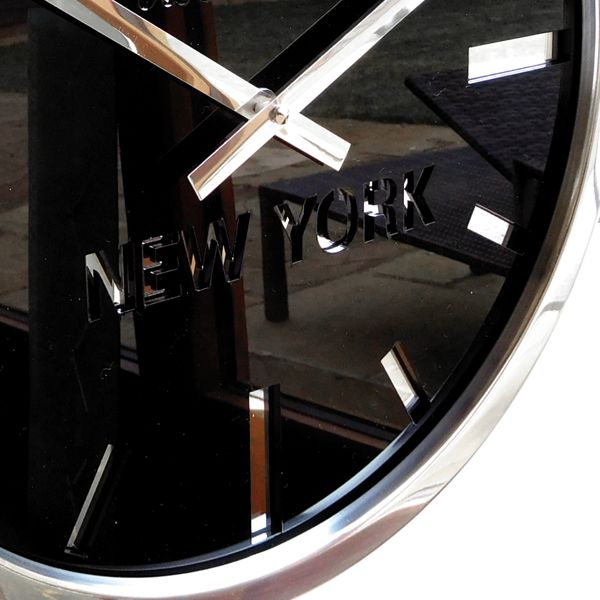side view of black timezone wall clock