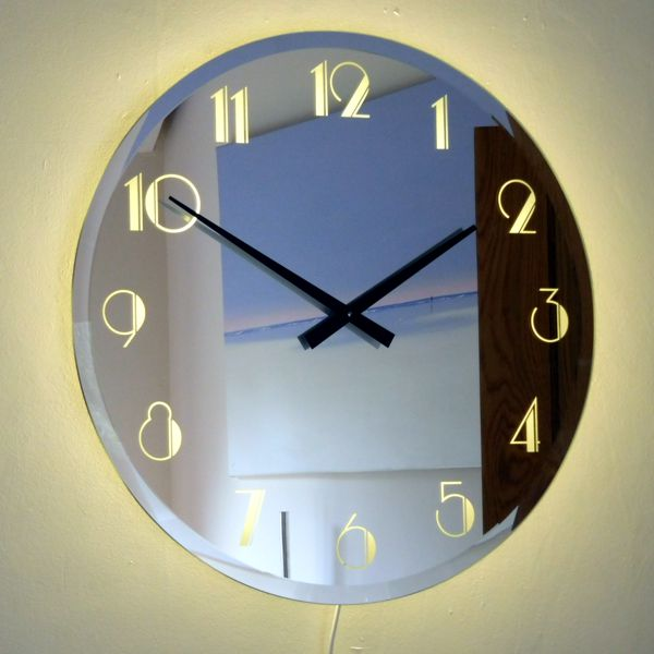 illuminated mirror wall clock with black hands