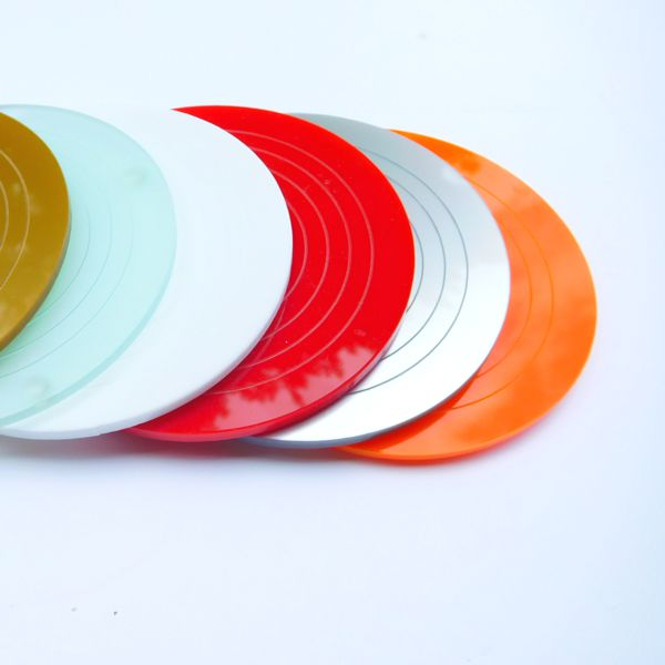 a row of gloss acrylic round coasters multiple colours